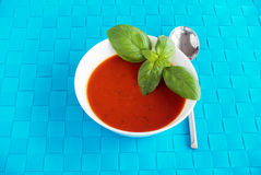 Tomato and basil soup decorated with basil leaves Royalty Free Stock Photo