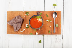 Tomato basil soup with tortilla chips Royalty Free Stock Images