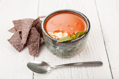 Tomato basil soup with tortilla chips Royalty Free Stock Photos