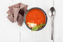 Tomato basil soup with tortilla chips Royalty Free Stock Image