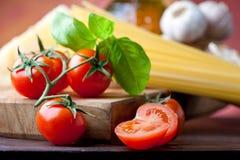 Tomato, basil and spaghetti Stock Photo