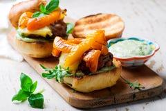 Tomato-Basil Turkey Burgers.style rustic. Selective focus Stock Photo