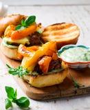 Tomato-Basil Turkey Burgers.style rustic. Selective focus Royalty Free Stock Image