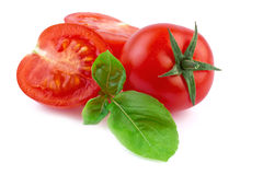 Tomato with basil  on white Royalty Free Stock Photos