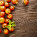 Tomato with basil on wood table.  stock photography
