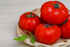 Tomato in the basket Stock Photography