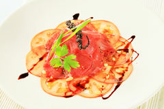 Tomato and beef Carpaccio Stock Images