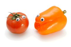 Tomato and bellpepper with eyes Stock Photos