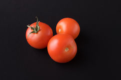 Tomato on black Royalty Free Stock Photography