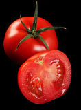 Tomato on black Stock Image