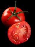 Tomato on black Stock Image