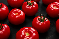 Tomato on a black background with realistic reflection and water drops. Fresh tomatoes. In a large amount Stock Photos