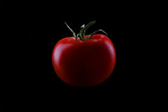 Tomato on black background Royalty Free Stock Photography