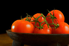 Tomato bowl. Tomatoes in a  wooden bowl Stock Photos