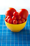 Tomato in bowl Royalty Free Stock Images