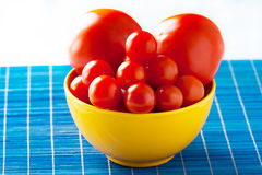 Tomato in bowl Stock Photos
