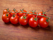 Tomato branch on vintage wood table Stock Photo