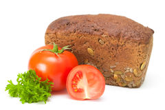 Tomato with bread. On a white background Royalty Free Stock Images