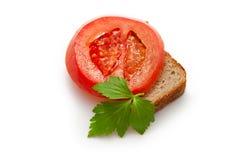 Tomato, bread, parsley Stock Photography