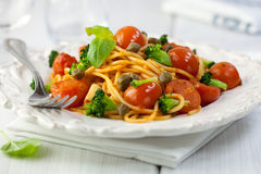 Tomato and broccoli pasta with capers Stock Photo