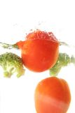 Tomato and broccoli vegetables splash Royalty Free Stock Photography