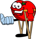 Tomato with a broken leg walking on crutches Stock Images