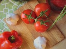 Tomato in Brown Chopping Board Royalty Free Stock Photo