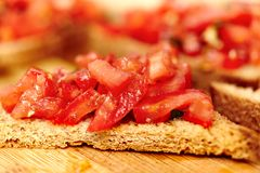 Tomato bruschetta on a wooden board Royalty Free Stock Images