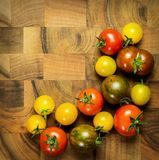 Tomato bunch on background. Tomato bunch on a wooden background Royalty Free Stock Image