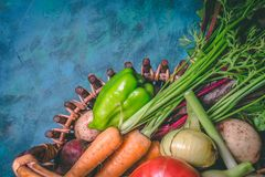 Tomato, cabbage, onion, potato, pepper, garlic, carrot and beetroot. Vegetables in a basket on a blue background. Copy space. Healthy food, agriculture royalty free stock photos