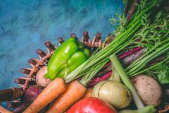 Tomato, cabbage, onion, potato, pepper, garlic, carrot and beetroot. Vegetables in a basket on a blue background. Copy space. Healthy food, agriculture royalty free stock image