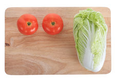 Tomato and cabbage on wooden chopping board. Prepare cooking Stock Photos