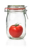 Tomato in a canning jar Royalty Free Stock Image