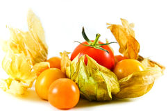 Tomato with cape gooseberry. Cape Gooseberry and Tomatoes are vitamins and beneficial to the body Royalty Free Stock Photo