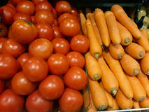 Tomato and carrot in grocery store. Red Tomato and Orange carrot in grocery store Royalty Free Stock Image