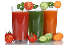 Tomato and carrot juice from vegetables isolated Royalty Free Stock Photos