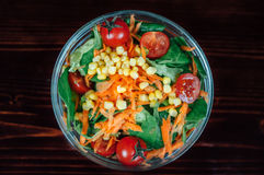 Tomato Carrots Corn Salad on Clear Glass Round Bowl Stock Image