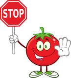 Tomato Cartoon Mascot Character Gesturing And Holding A Stop Sign Stock Photo