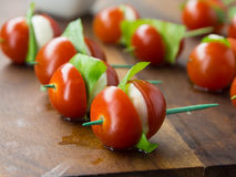 Tomato and cheese apetizer. On a toothpick Royalty Free Stock Photography