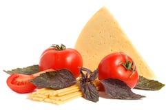 Tomato, cheese, macaroni and basil Royalty Free Stock Image