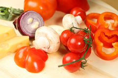 Tomato, cheese, onion on wooden plate Royalty Free Stock Photography