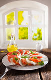 Tomato and cheese salad with an oil dressing Stock Images