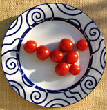 Tomato cherry. In a plate Royalty Free Stock Photography