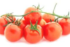 Tomato cherry. Tomato-cherry heap isolated over white Stock Photography