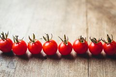 Tomato cherry in basket Tomato in hand South Asia. Nature light stock photo