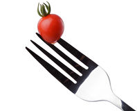 Tomato cherry on a fork Stock Image