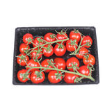Tomato cherry in packing. Branch of tomato cherry, closeup on white background Stock Photography