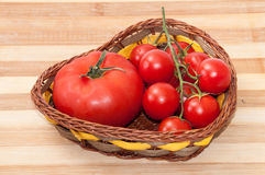 Tomato and cherry tomatoes in a basket Royalty Free Stock Photo