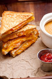 Tomato chickpea soup and grilled cheese and tomato sandwiches. Grilled cheese and heirloom tomato sandwiches and tomato chickpea soup Stock Images