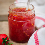 Tomato and Chili Jam in a Clear Jar Stock Images